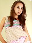 Sensual brunette hottie teasingly lifts her blouse